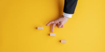 hand climbing wooden blocks