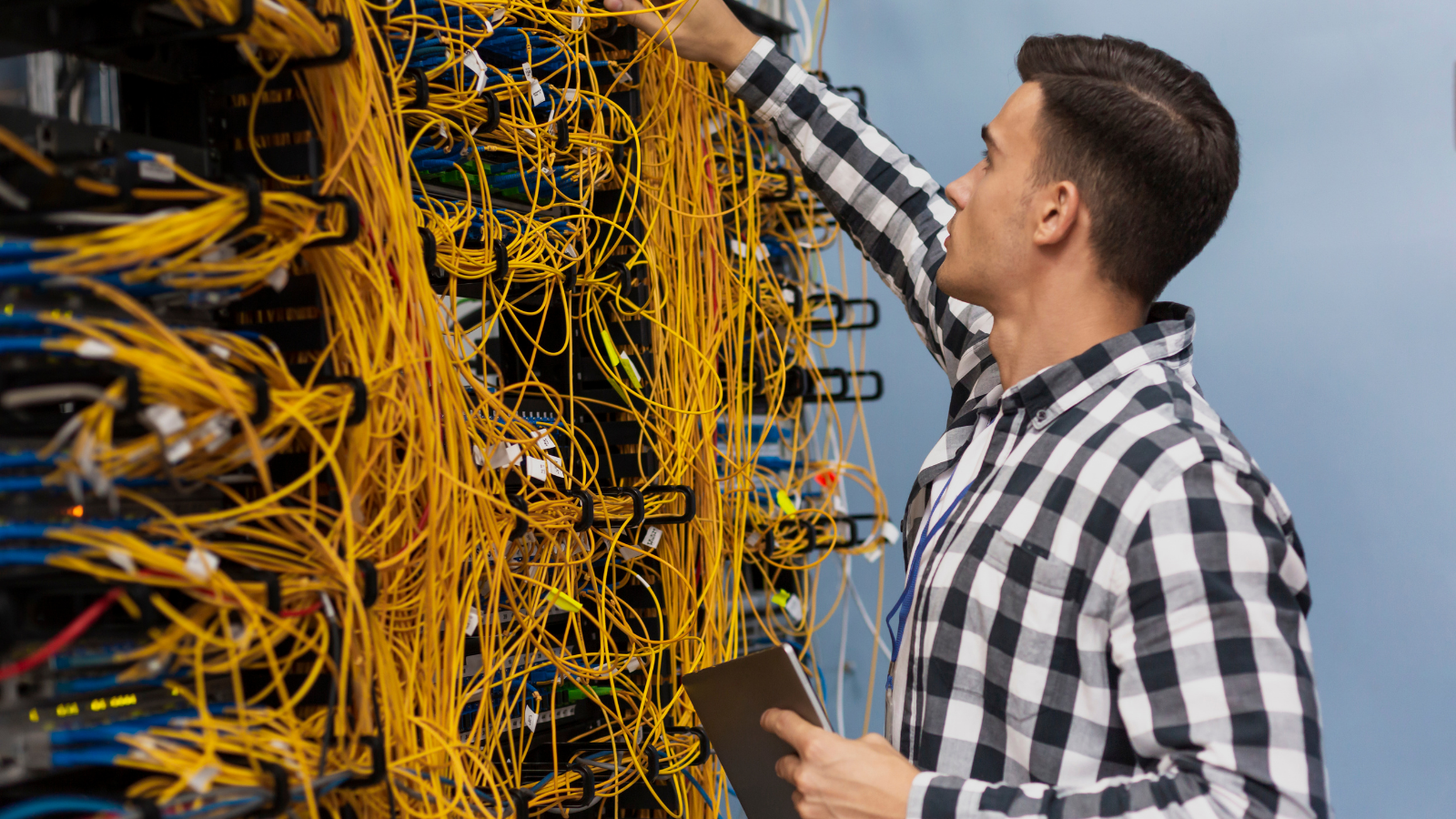 man fixing an IT outage